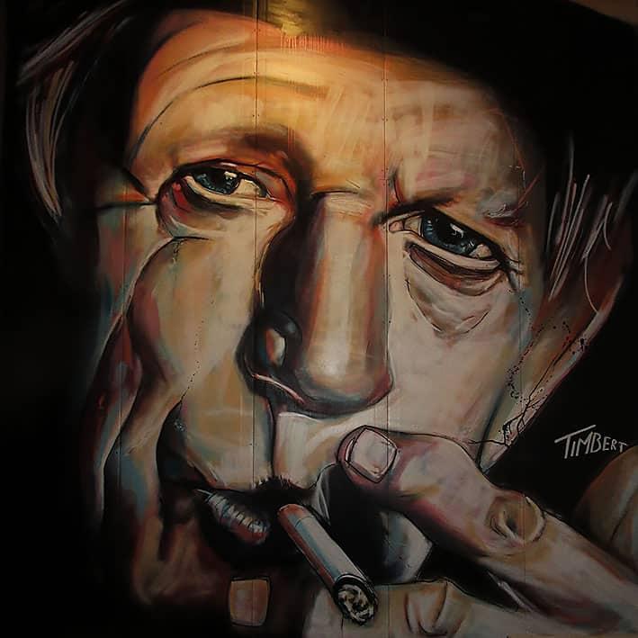 portret muurschildering van gitarist van the Rolling Stones Keith Richards. gemaakt met spuitbus en stift op acryl en waterbasis door timbert